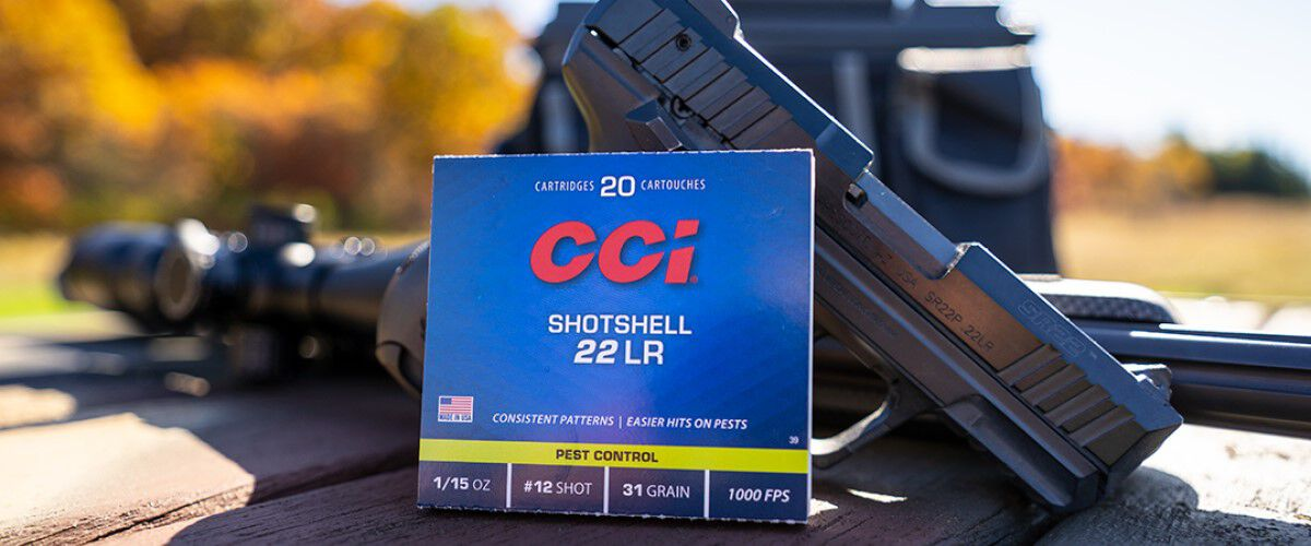 CCI Pest Control Packaging laying agains a rifle and handgun