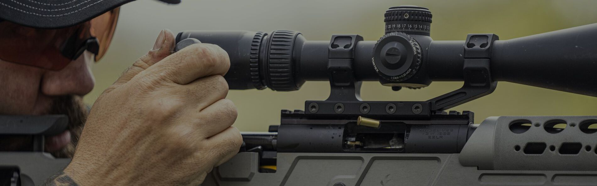 Man looking down the scope of a rifle