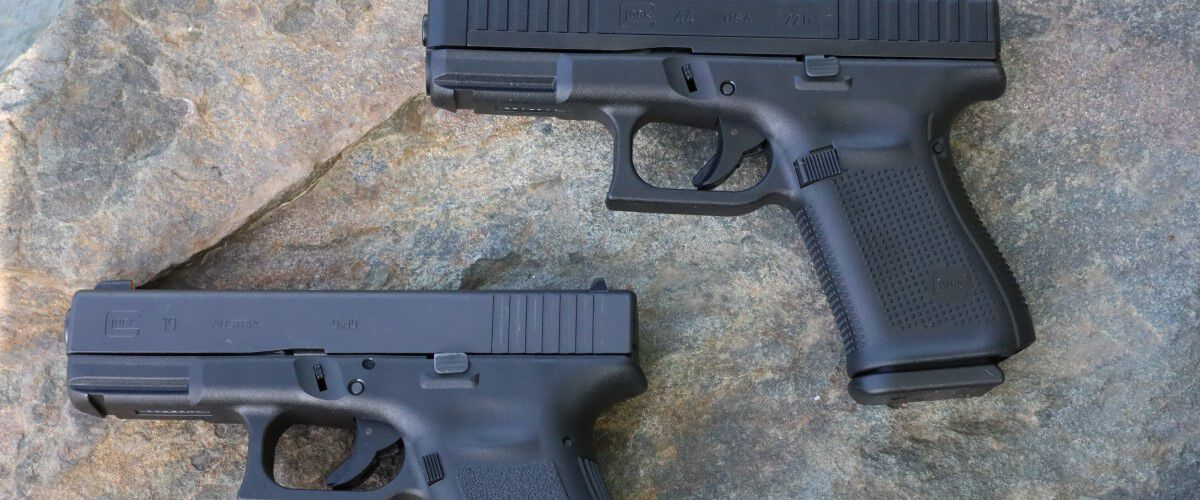 two handguns laying on the floor