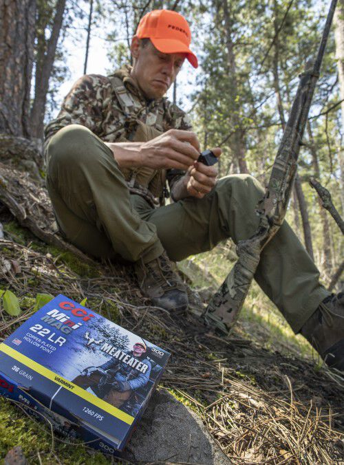 Steven Rinella loading MeatEater Series Ammunition outdoors