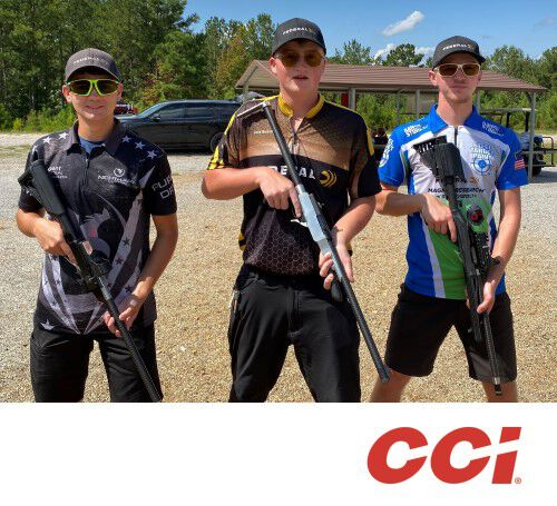 Chris Barrett, Cole Busch, and Gran Kunkel holding rifles