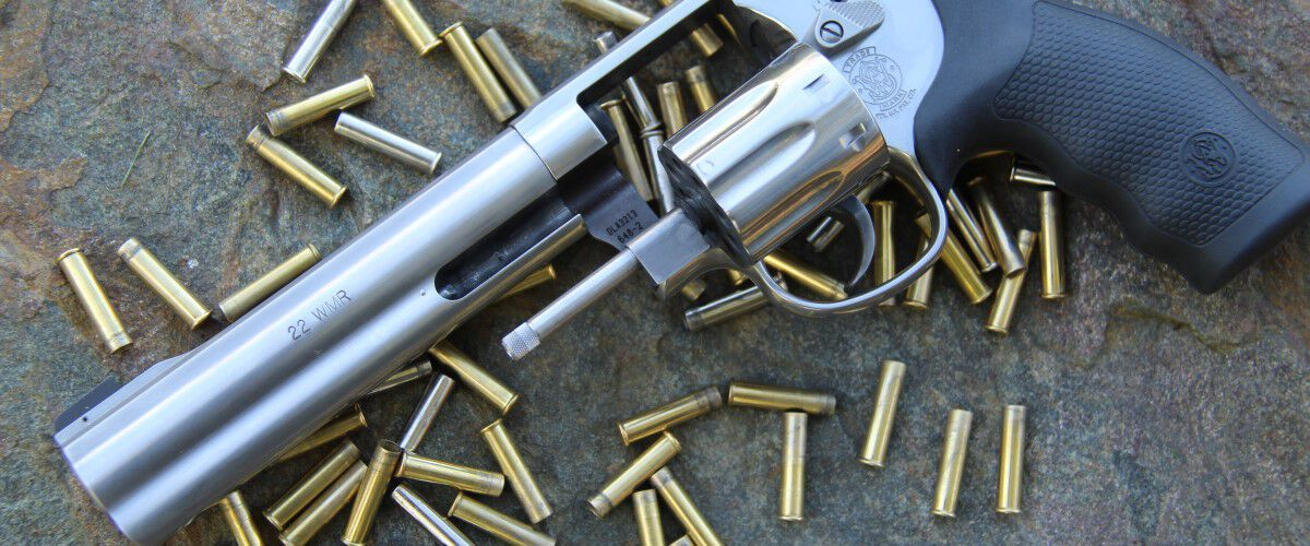 unloaded pistol with loaded cartridges laying underneath