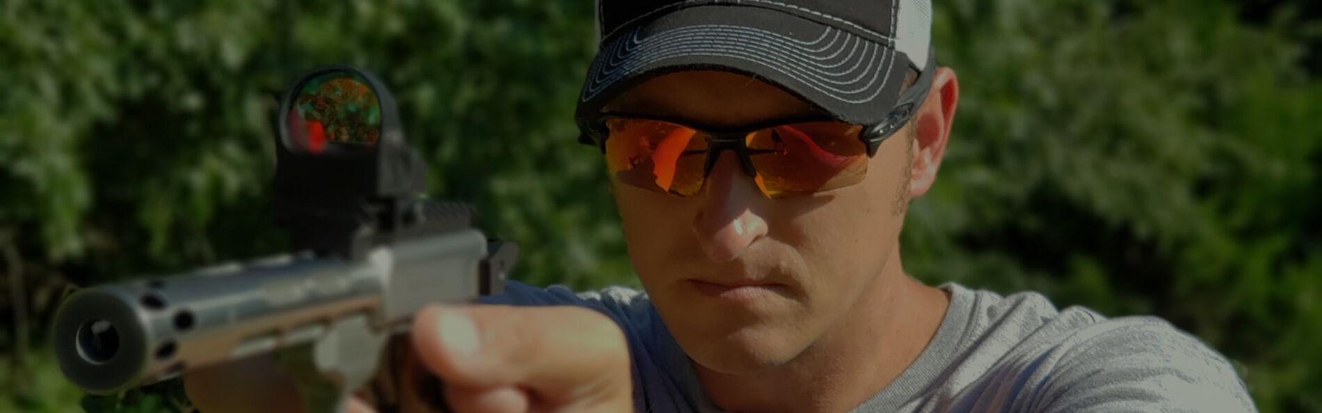 22plinkster aiming a handgun