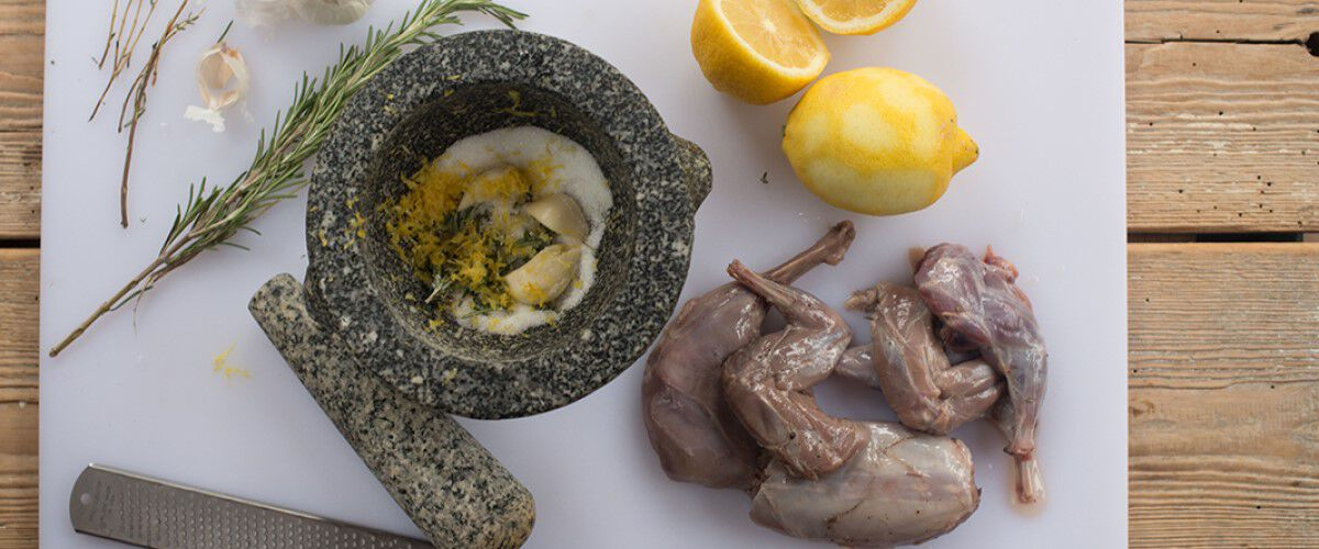 Raw Rabbit, Lemon, and other ingrediants in a mortor