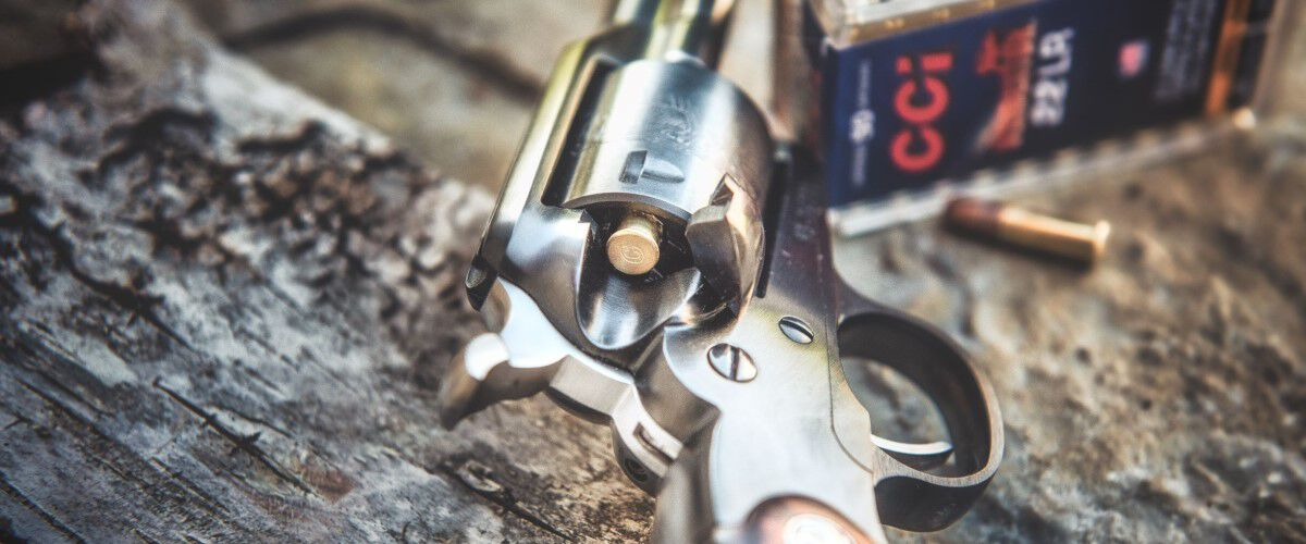 handgun with CCI ammo in the background