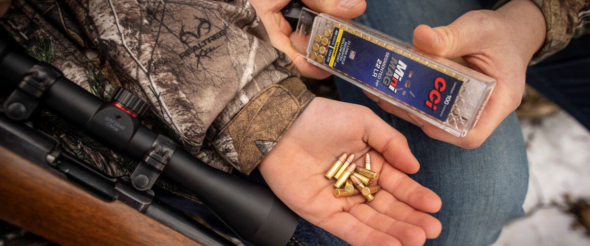 hunter holding MiniMag 22LR rounds in his hand