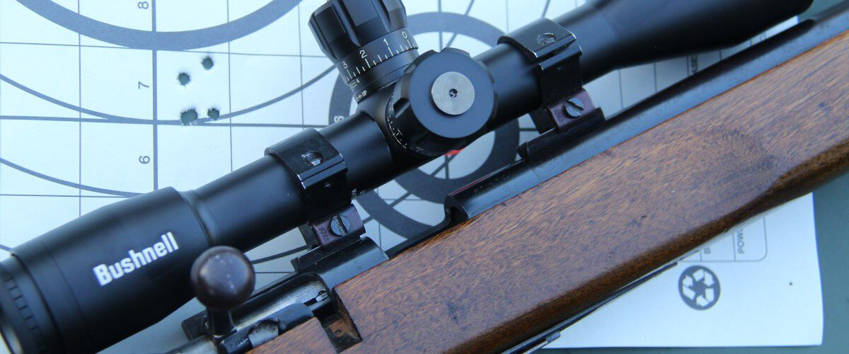 rifle laying on top of a shot target