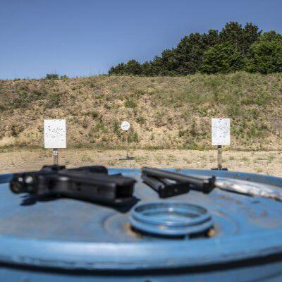 Outdoor Target Range with a Handgun resting on a blue barrel