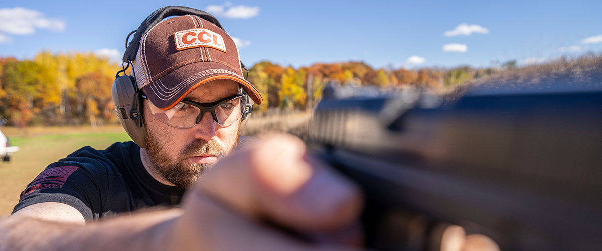 shooting rimfire handgun at an outdoor range