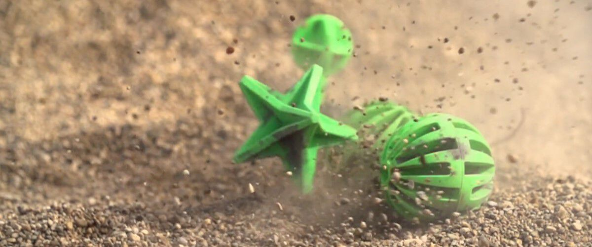 green star target and round ball target sitting in the dirt