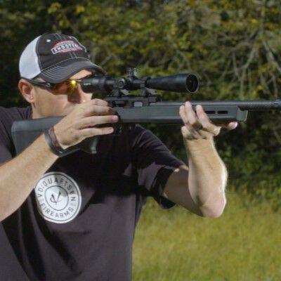 22plinkster shooting a rifle outside